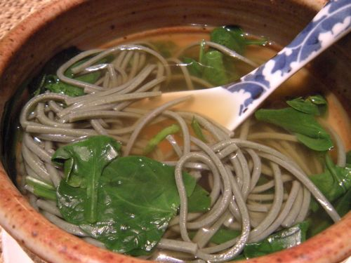 soba noodles in dashi broth with fresh baby spinach