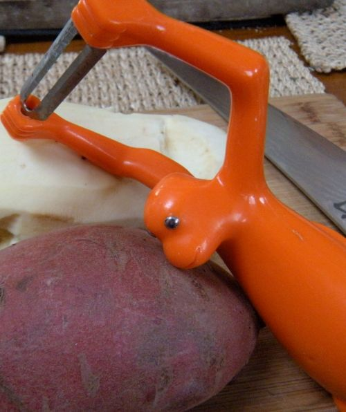 raw sweet potatoes with peeler . . .