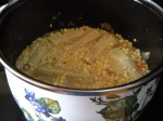 corn and cobs simmering in homemade vegetable broth . . .