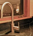 a Grohe faucet in brushed nickel finish . . .