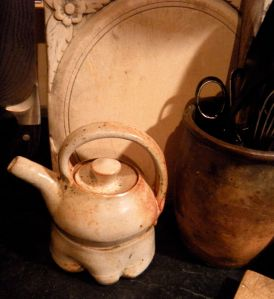 shino teapot with carved breadboard and redware. . .