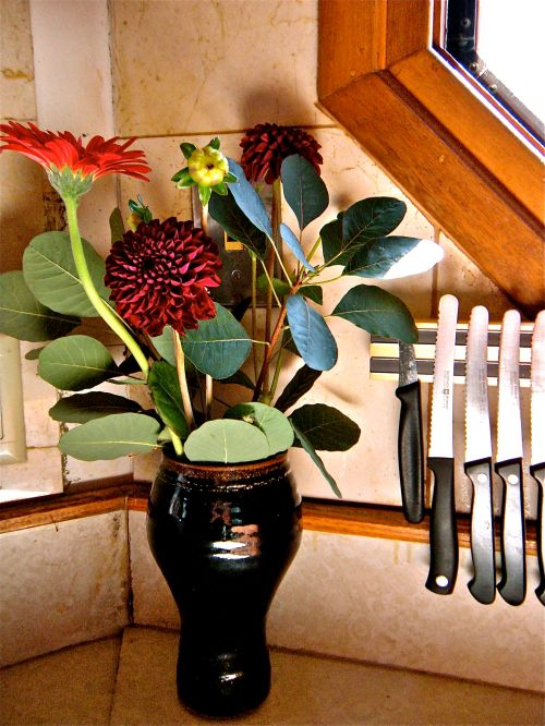 dahlias and gerbera with knives on the old formica countertop . . .