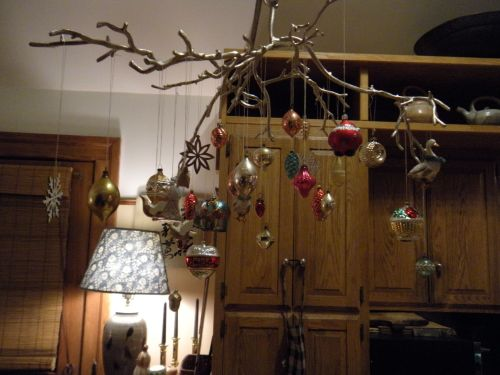"an ornament ""branch"" over the kitchen table. . ."