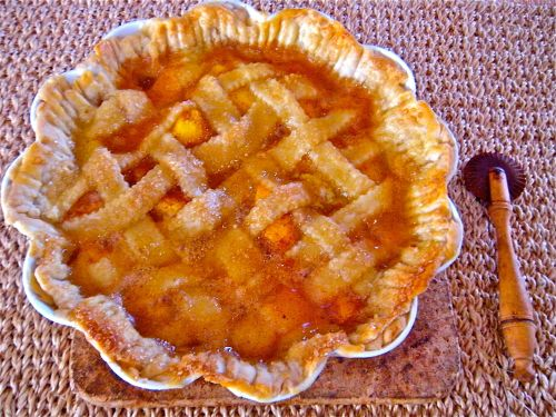 peach pie with pastry wheel