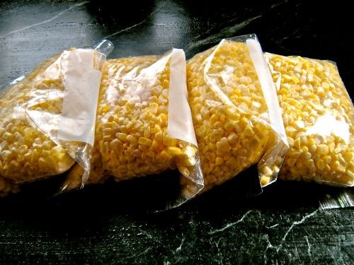 a dozen ears of corn, ready to freeze . . .