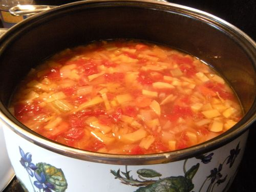 simmering vegetable soup before cabbage is added. . .