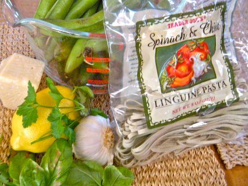 ingredients: fava beans, fresh garlic, basil, parsley, lemon & Trader Joe's spinach-chive linguine. . .
