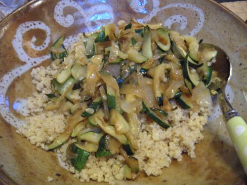 cooked millet with zucchini and onions. . .